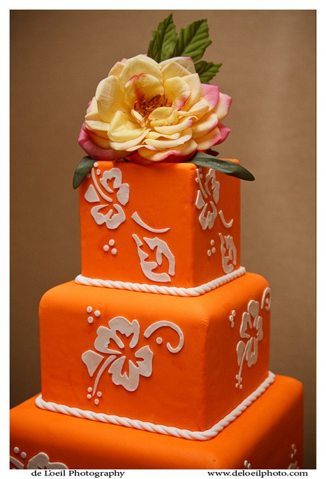 Vibrant, beautiful orange wedding cake! #BroncoNation #BoiseState