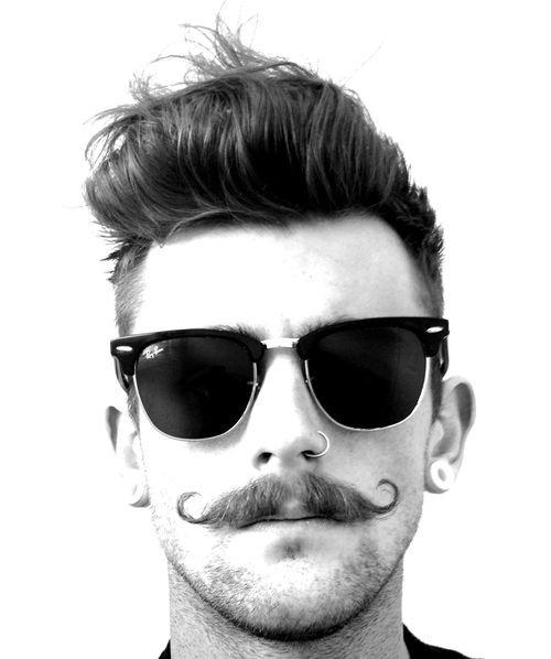 A good old curled tache sets of many looks, just not with Ray Bans, your'e not trying to be hipster, just unique.