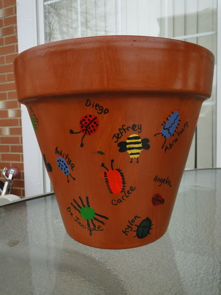 Disney dreamer designs terra cotta flower pot with thumb print bugs