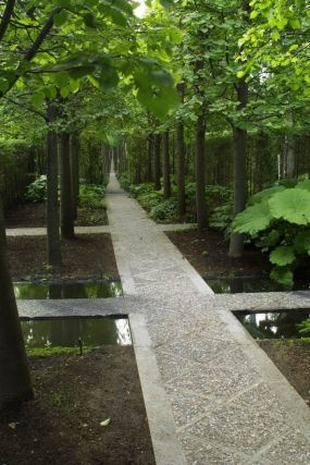 Les Quatre Vents...there is  mirror at the end of the pathway creating the illusion it goes on forever - beautifully done