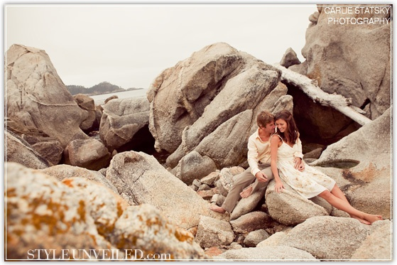 Photographer Carlie Statsky snaps a beautiful image of a couple snuggling on the rocks