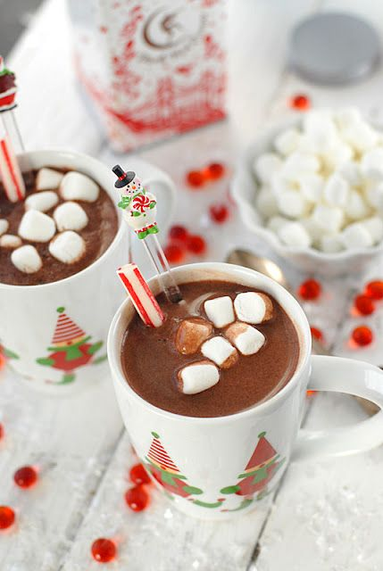This is one of my most favorite holiday drinks. Hot chocolate with mini marshmallows and a candy cane to stir.