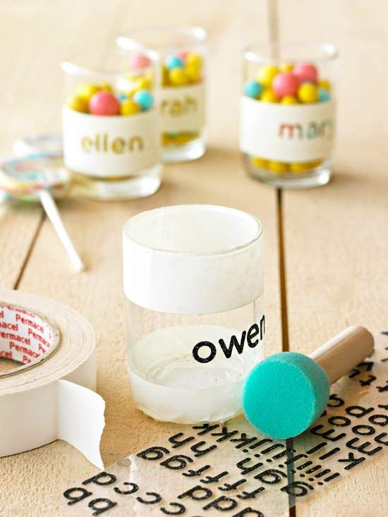 Personalize thrift store glasses. Spell out a name w/ stickers. Tape off top and bottom. Dab acrylic paint lightly over the stickers and untaped area. Apply 2 coats. Unpeel and you're done!