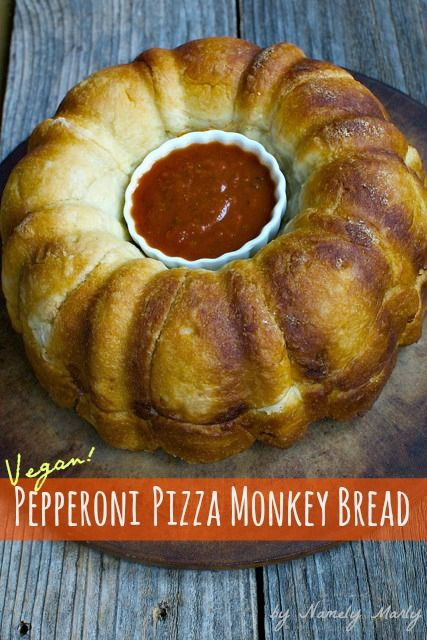 Vegan Pepperoni Pizza Monkey Bread served with marinara sauce.