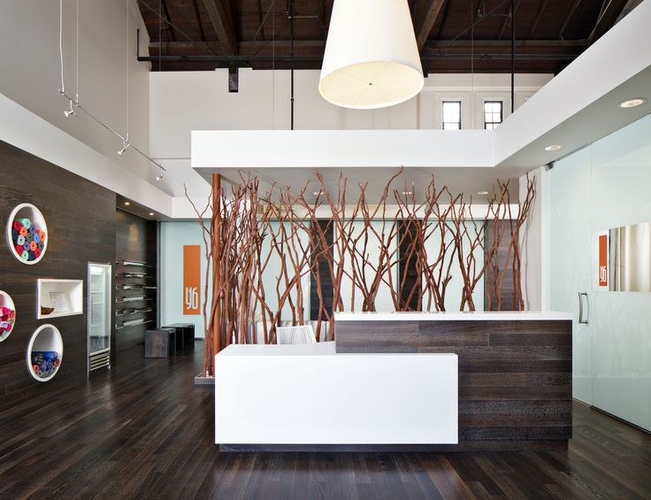Good Office Reception Area Design With Chocolate Brown Desk And White Gypsum Ceiling Ideas 1024x526