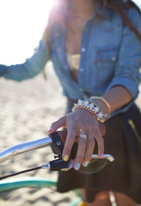 beach. bike. denim jacket. spikes. neon nails.