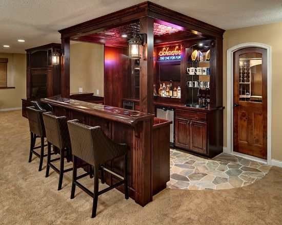 Basement Design love the bar. Really love the storage room right behind it.