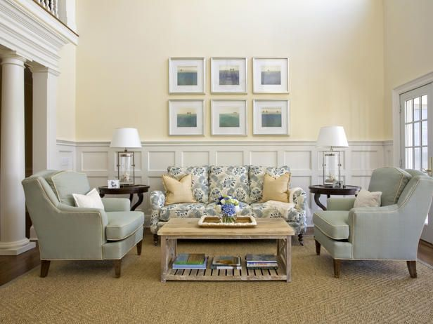 Traditional Living Room With Cream Walls Wainscot Panels