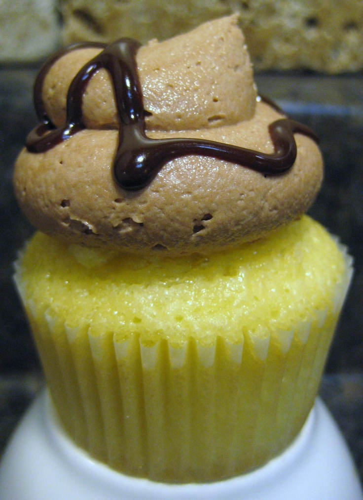 vanilla cupcake filled with vanilla pudding and topped with chocolate ...