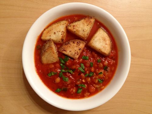 Lentil, tomato, zucchini, onion, an garlic soup with garlic potatoes.