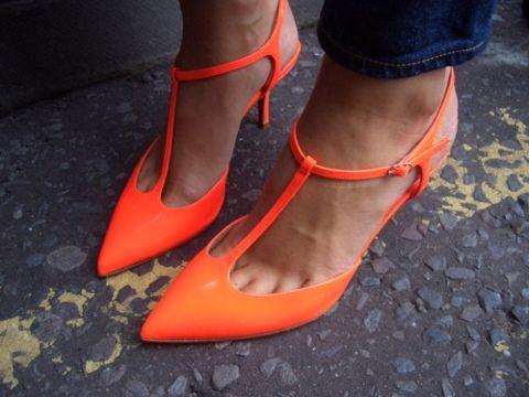 Neon orange t-strap pumps.