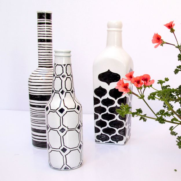 turn glass bottles into decorative vases with spray paint and sharpies. Black Bedroom Furniture Sets. Home Design Ideas