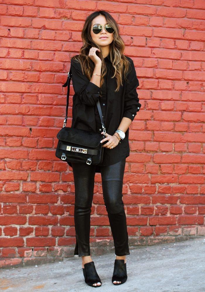 black shirt leather pants with handbag