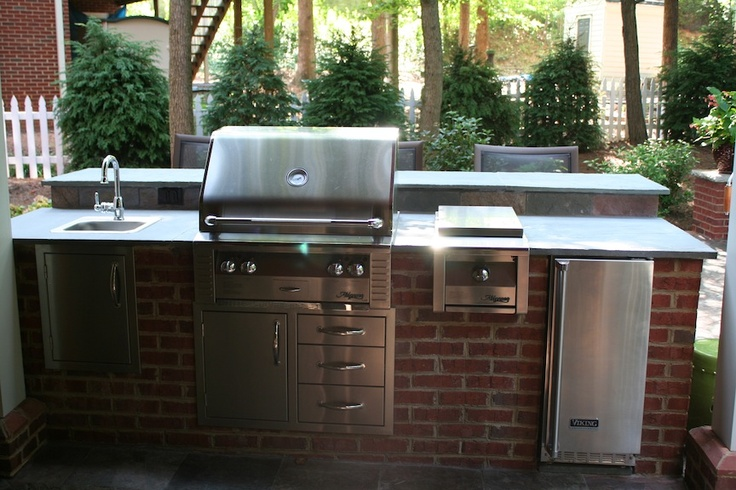 red brick outdoor kitchen island with raised seating bar On brick outdoor kitchen