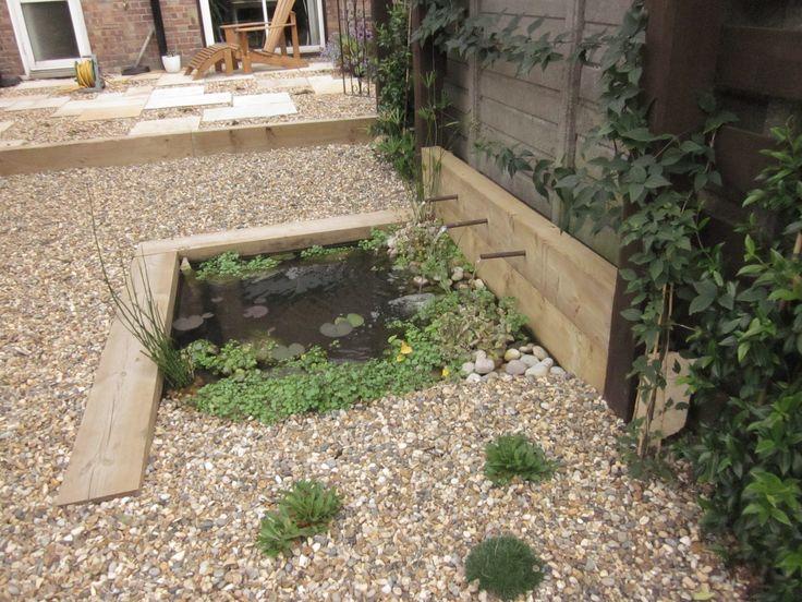 Pond with railway sleeper edging patio pond ideas for Sleeper garden designs