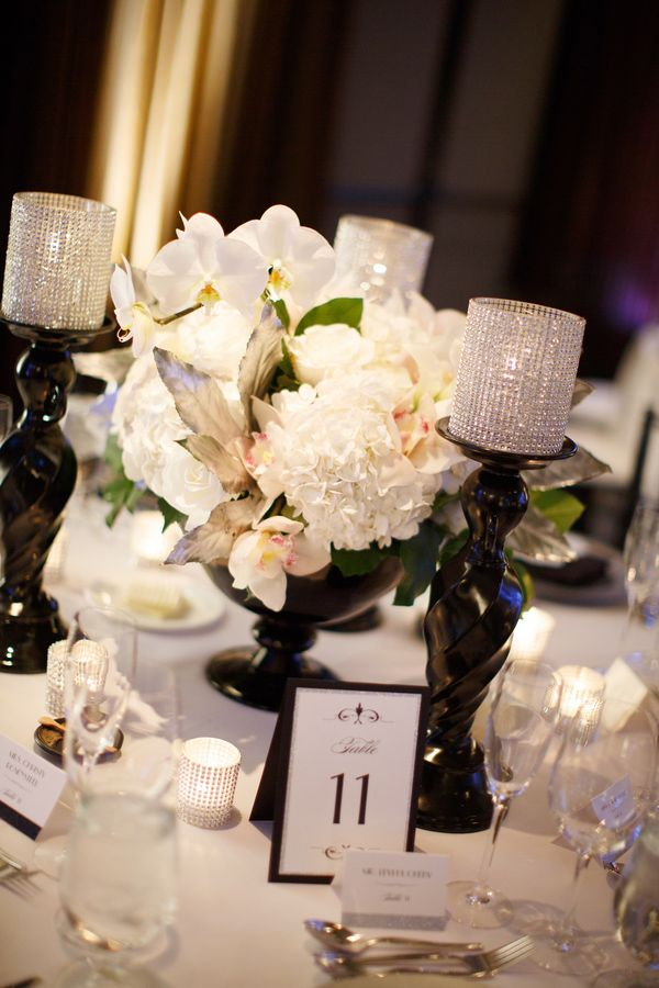 Black, white, and a bit of shimmer! We love these elegant table settings. #blacktiewedding