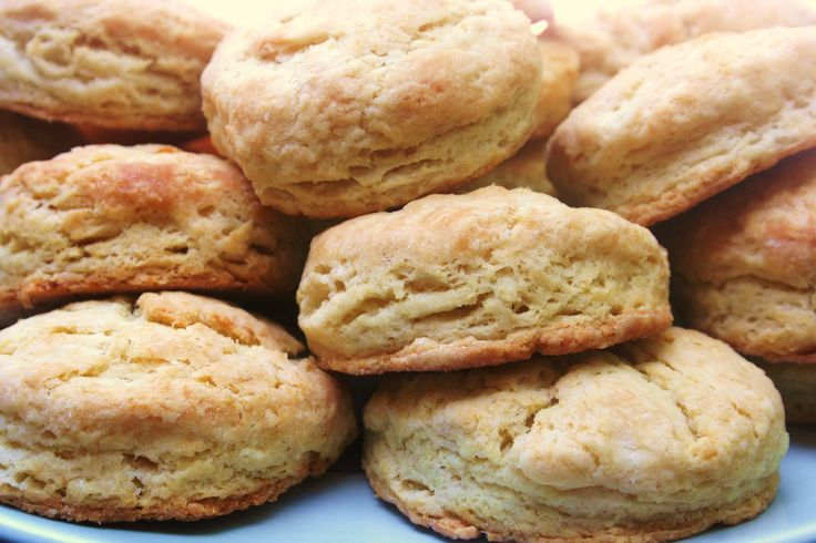 basket of warm toasty little Flaky Buttermilk Biscuits belongs on ...