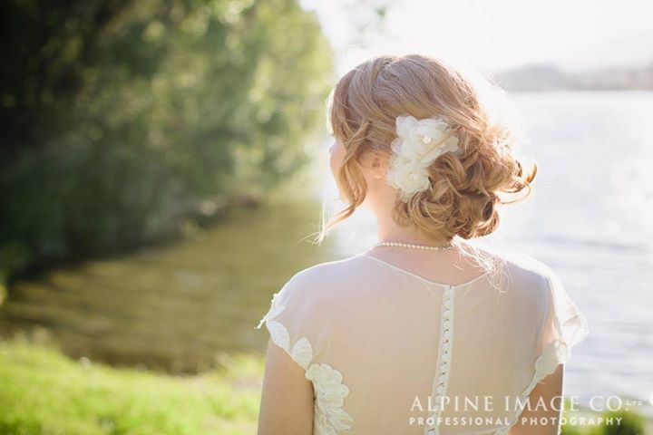 Bridal hairstyle side messy bun with silk flower Queenstown wedding ...