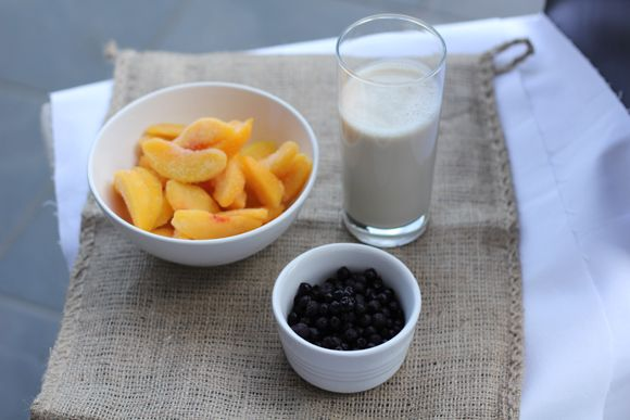 1 cup frozen blueberries  1 1/2 cups frozen peaches  6 ice cubs  1 cup water  1 cup almond or soy milk, or orange juice  1/4 cup greek yogurt  1 T agave nectar (optional)