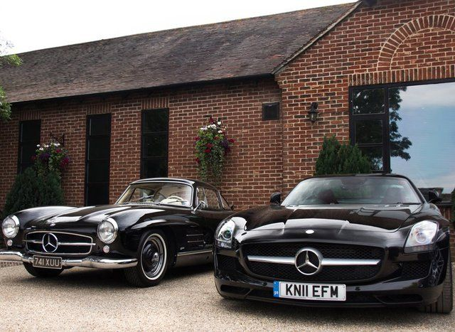 old and new Mercedes Benz SLS
