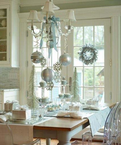 Pale blue and white snowflake theme, hang ornaments on ribbons from the chandelier.  - Christmas Dining Room Decorating Ideas, Decor for a Holiday Dinner Party