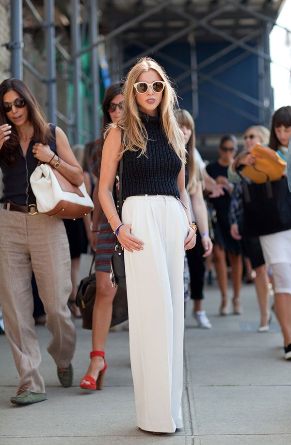 Kerry Pieri pairs a cropped Alexander Wang sweater with wide-leg pants by Rodebjer