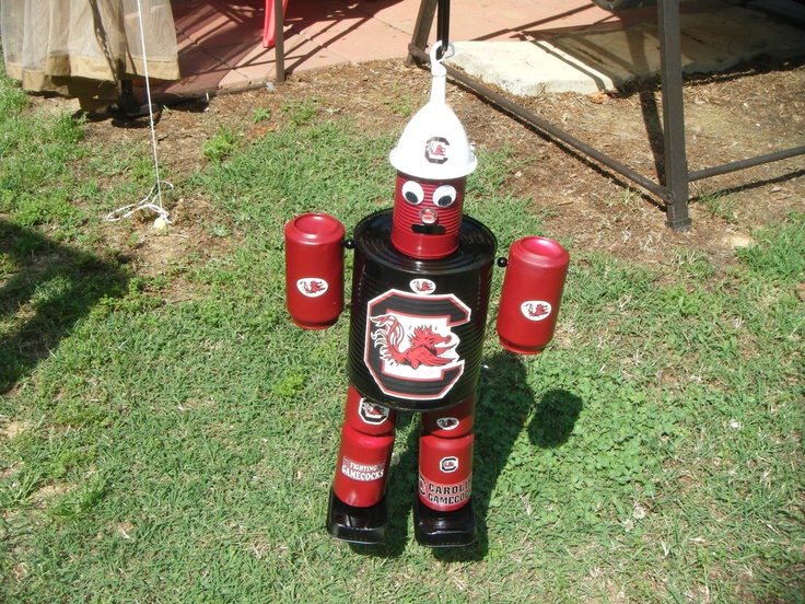 Tin man bird feeder made out of cans outside garden for Tin man out of cans