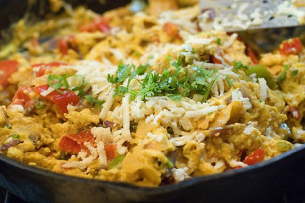 migas--a scrambled egg dish loaded with onions, tomatoes, peppers, and ...