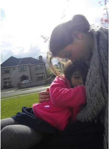 A very tender moment between child and Au Pair.