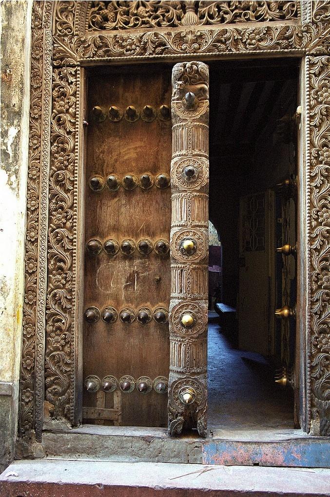 Carved door in stone town zanzibar the doors pinterest for Door of stone