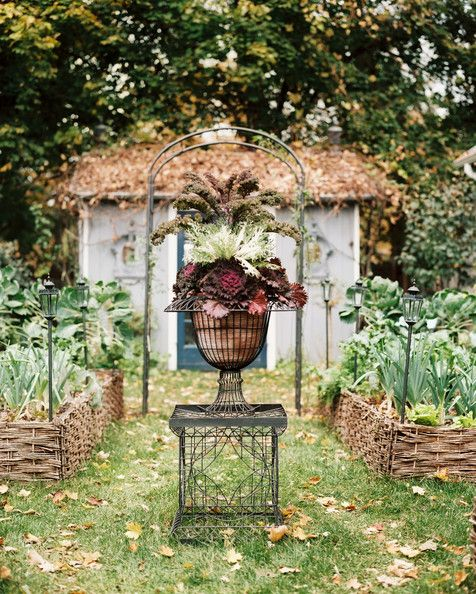 xx..tracy porter.. poetic wanderlust...-Garden - An urn filled with colorful vegetables in a garden with raised beds