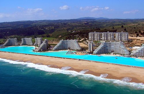 Swimming pool is adjacent to the ocean.