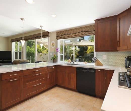 Modern U shaped Pale Yellow kitchen, cherry, fir cabinets,