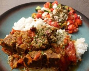 MiLady's Moroccan Lamb Tagine with Mediterranean salad over rice.