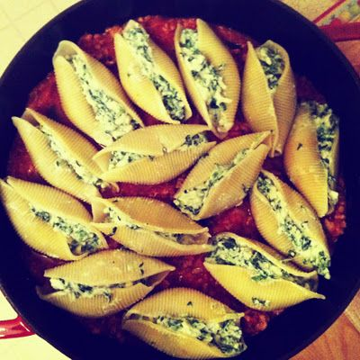 Spinach and cheese stuffed shells with meat sauce