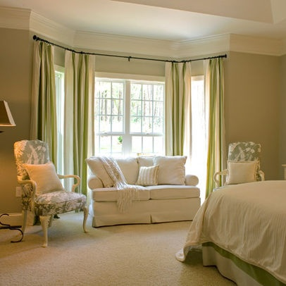 a sitting area in the master bedroom for the home