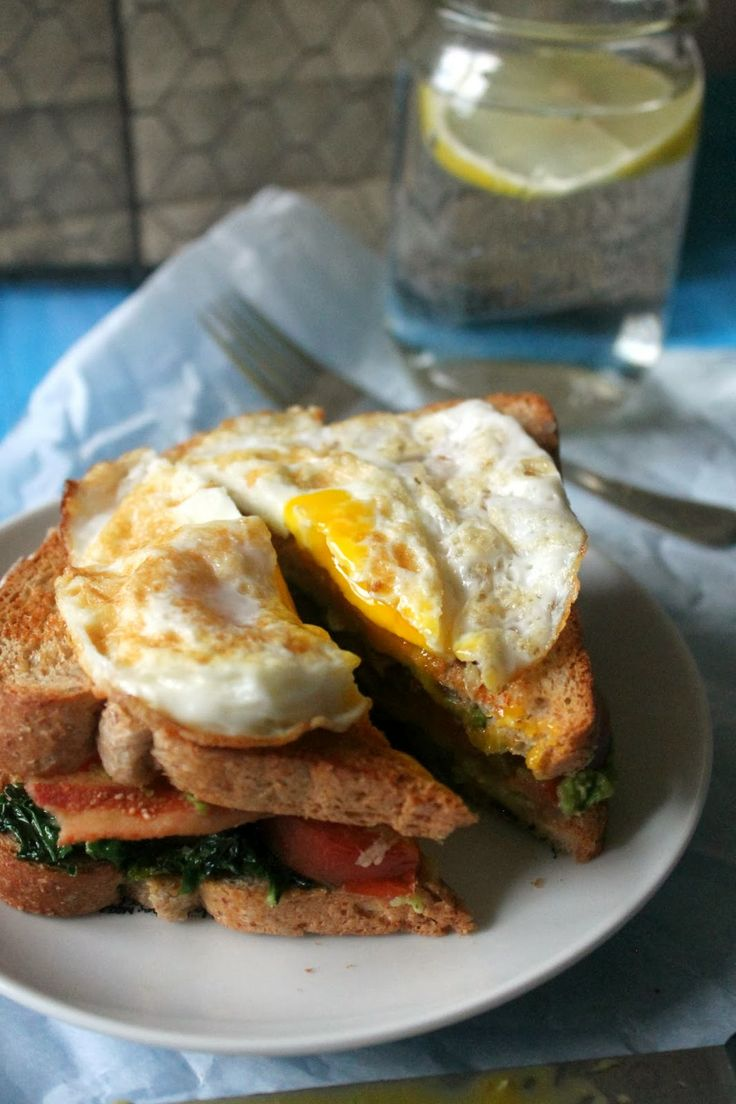 Bacon, Kale, Tomato & Avocado Sandwich with a Fried Egg
