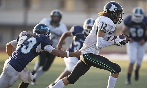 If not for Mount Rainier's Donovan Moi grabbing a piece of his shirttail, Kentwood's Terence Grady is gone in second-quarter action Friday night. See more of Seattle Times photographer Dean Rutz's photos from the game.