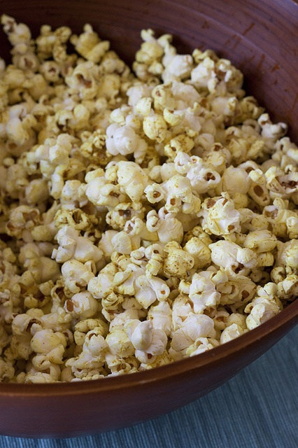 curried popcorn - I make this with butter, honey & curry: winner.
