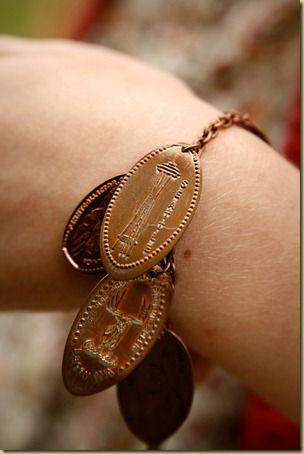 Pressed Penny Charm Bracelet! AWESOME IDEA! For all those times you are traveling and talk yourself into getting a pounded penny. Now I wish I had some from all my travels!!
