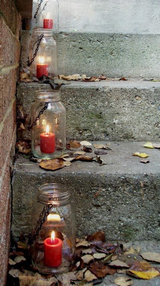 Candles in Mason jars bordering the balcony