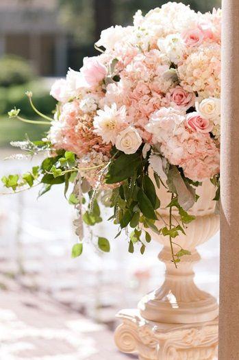 Elegant pink floral pillar arrangement