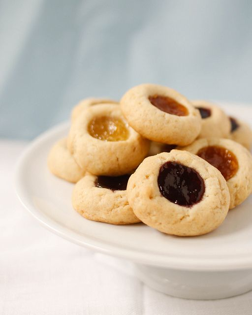Jam thumbprints. The secret to the rich and tender cookie is cream ...