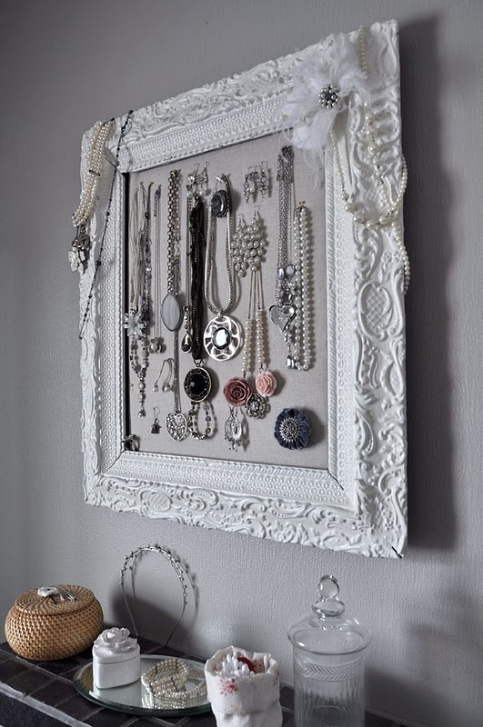 This is so pretty and simple.  All you need is an old frame, some spray paint, and fabric/cork.  A fun DIY projec