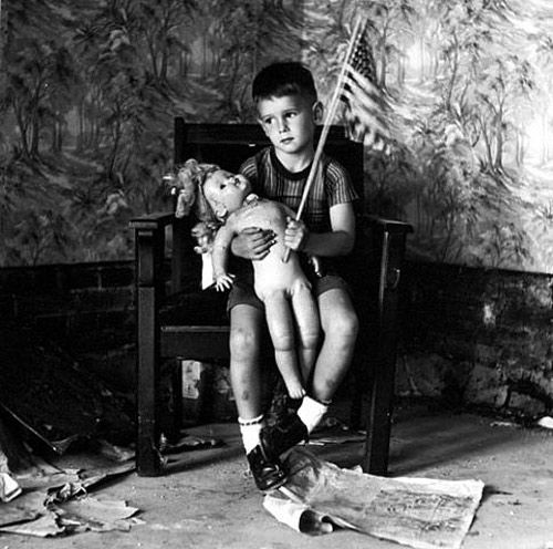 Untitled boy with flag by ralph eugene meatyard