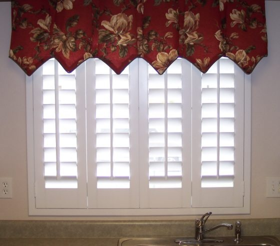 Plantation shutter kitchen window treatment ideas for Shutter window treatment ideas