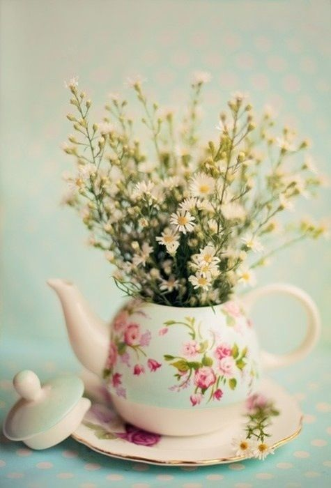 Flowers planted in tea pot for some vintage charm