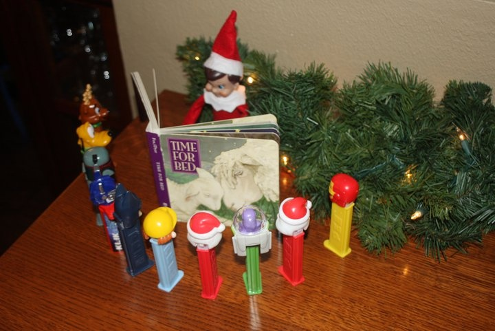 Elf on a Shelf reading to the PEZ guys...