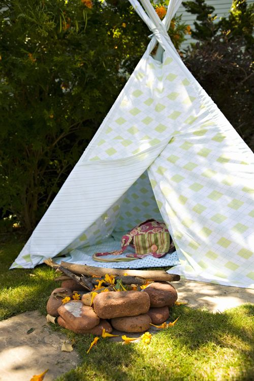 Set up a tent with PVC pipes and fabric or sheets for your camping theme party!