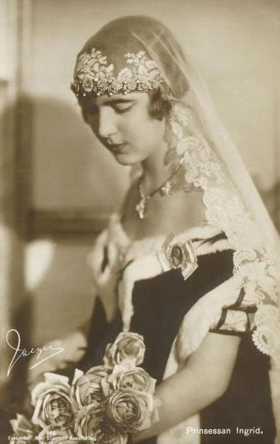 Ingrid Victoria Sofia Louise Margareta, Queen of Sweden married then Crown Prince of Denmark, later Frederik IX of Denmark, wearing this veil that has been worn by all her female descendants at their weddings.